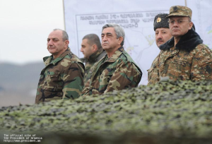 Armenian President Serzh Sargsyan, (centre), in military fatigues on the Nagorno-Karabakh frontline in 2012.