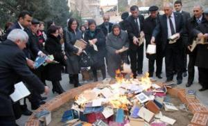 Books of Akram Ayisli being burnt in the city of Ganja.